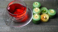 Blowing away of candles and a cup of Herbal tea. - stock footage