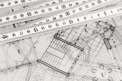 architecture blueprints - house plans & folding ruler - stock photo