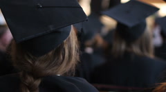 Young female in academic dress at diploma award ceremony, listening to lecture - stock footage