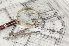 architecture blueprint -  house plans, magnifying glass & compass - stock photo