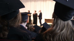 College headmaster presenting graduating students with certificates, handshake Stock Footage