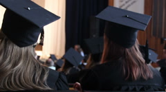 Group of excellent students walking to stage to receive diplomas with honors - stock footage