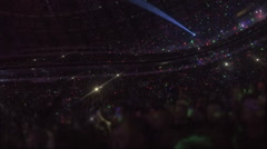 Amazing light effects at arena with thousands of people enjoying music show Stock Footage