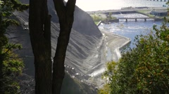 Looking down at the side of a rocky mountain beside the Montmorency Falls Stock Footage