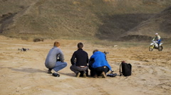 a team of young engineers is preparing for autonomous flight 4 quadrocopters - stock footage