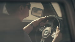 Man nervously wait then driving a sport car - stock footage