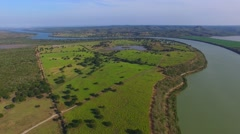 Ariel-shot of river & land Stock Footage