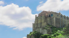 Old monastery on top of mountain. Time-lapse of clouds moving in sky over church Stock Footage