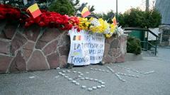 Flowers and candles memorable memorial, the Belgium Embassy in Kiev, Ukraine. Stock Footage