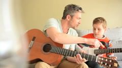 Daddy with son playing the guitar Stock Footage