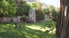 2 Students Run to Join Group of Students at Castle Tower - stock footage