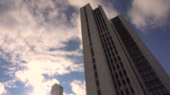 Skyscraper View From Below Against a Background of Running Clouds Taymlaps Stock Footage