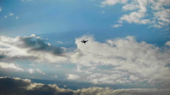 Drone hovered in the background of the sky. Modern technology in operation - stock footage