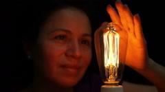 Woman Antique Filament Bulb Amusement Front Stock Footage