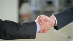 Two co-workers (man and man) do an handshake with vigour. - stock footage