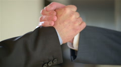 Two co-workers do an handshake with enthusiasm. - stock footage