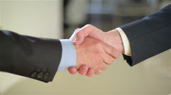 Two co-workers (man and man) do an handshake (with more shaking). - stock footage