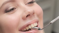Dentist examines incisors of patient Stock Footage
