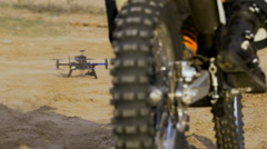 Quadrocopters takes off from the ground. Professional photography motocross Stock Footage
