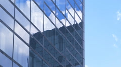 Skyscraper all-glass elevation with reflection of sky and cloud. Stock Footage