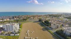 Aerial shot of luxury villas along coastline. Blue sky, sunny day, summer resort Stock Footage