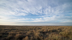 Timelapse of high clouds over morning prairie in Montana Stock Footage
