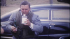 3239 men drinking before going fishing at the lake - vintage film home movie Stock Footage