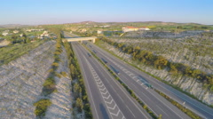 Aerial shot of active traffic on modern freeway. Beautiful landscape, horizon Arkistovideo