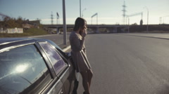 Girl Smoking near the Car in front of the Countryside Bridge Background - stock footage