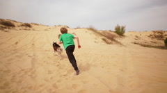 Kids playing and doing sport on sand. Slow motion Stock Footage