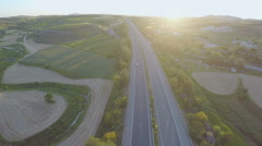 Busy traffic on motorway. Aerial shot of road, beautiful nature. Amazing sunset Arkistovideo