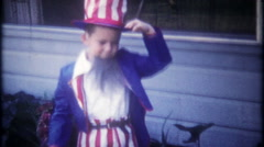 3243 young boy dressed as Uncle Sam wearing a mask - vintage film home movie Stock Footage