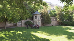 Group of Students listen to Knight Teaching at Castle Stock Footage