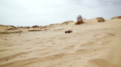 Family spending time together and having fun in Oleshky sands.Ukraine. Slow Stock Footage