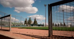 Motion time-lapse of baseball field from dugout Stock Footage