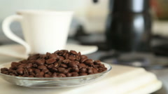 Moka pot brewing coffee on a stove Stock Footage