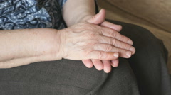Woman strokes an old wrinkled woman's hand Stock Footage
