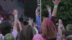 DJ performance on stage, crowd of fans enjoying music, jumping, waving hands Stock Footage