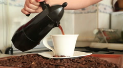 Hand hold moka pot fill the coffee into the cup Stock Footage