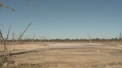 Dry Dirt Lake Bed in Drought under Blue Sky in Australia Stock Footage