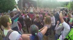 Mass of positive people raising hands up, slow motion, enjoying fest atmosphere Stock Footage