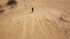 Little kid walking alone in Oleshky sands.Ukraine. Slow motion Stock Footage