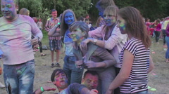 Happy young guys in good mood hugging, laughing, enjoying paint fest atmosphere Stock Footage