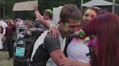 Guy holding girlfriend in arms, young people hugging, fooling around at festival - stock footage