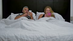 Happy couple on bed good night kiss Stock Footage