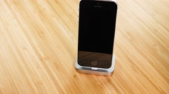 Rotation of the new iPhone in docking station Stock Footage