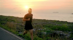 Male runner in sport dress running slow motion Stock Footage