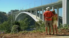 Couple contemplating Arrbida Bridge, Porto, Portugal - stock footage