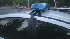 Close-up flashing lights of emergency vehicle, blue flashers on police car, 911 Stock Footage