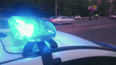 Closeup blinking strobe lights on police car, blue lightbar, emergency situation Stock Footage